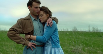 "Emory Cohen as ""Tony"" and Saoirse Ronan as ""Eilis"" in BROOKLYN. Photo courtesy of Fox Searchlight Pictures.  © 2015 Twentieth Century Fox Film Corporation All Rights Reserved"