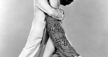 1953: Fred Astaire (1899 - 1987) and Cyd Charisse perform a dance number in the film 'The Band Wagon', directed by Vincente Minnelli for MGM.