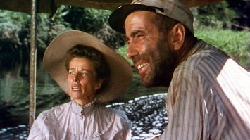 """CHARLIE ALLNUT (HUMPHREY BOGART) AND ROSE SAYER (KATHERINE HEPBURN) ABOARD """"THE AFRICAN QUEEN"""" *** Local Caption *** Feature Film"""